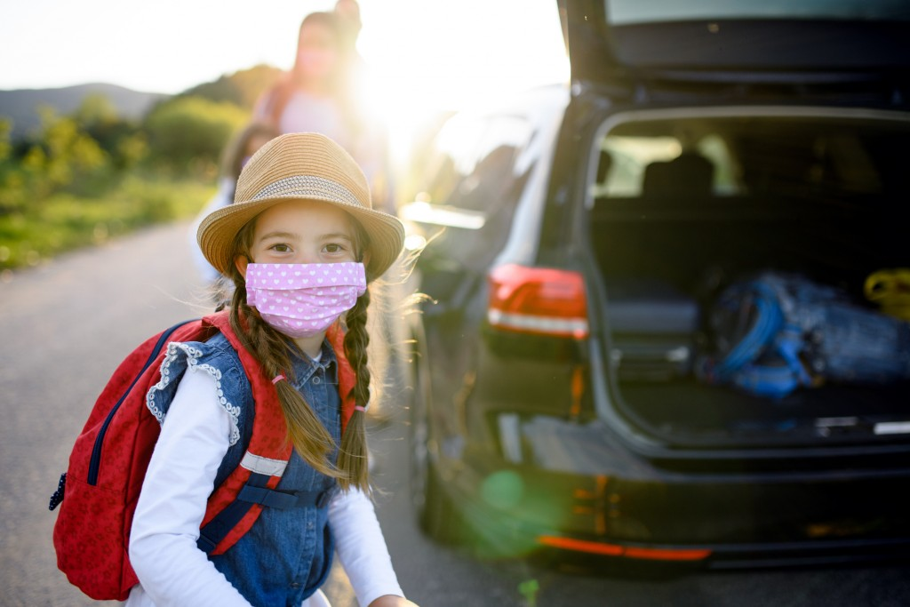 Small Girl With Family On Trip Outdoors In Nature, Wearing Face Masks.
