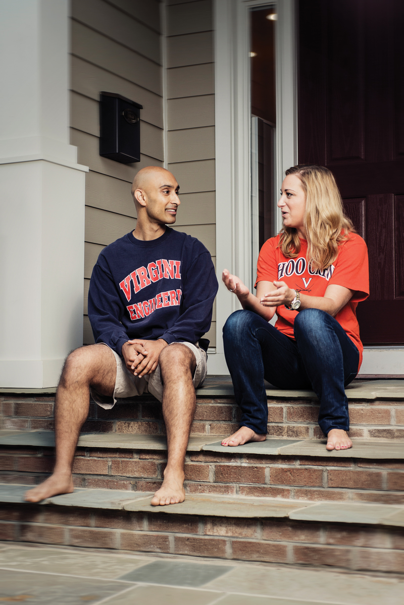 "Sunny DiSoco sits on the steps of his home near Washington-Lee High School with fellow Arlingtonian Aubyn Carraway. Carraway was the recipient of his ""Ideal Scholarship"" at U.Va. four years in a row. She graduated in 2011 and now works as a senior marketing analyst. Photo by Erick Gibson"